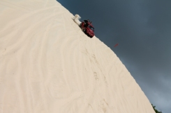 Going down a steep sand dune